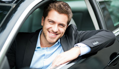 Happy Man Smiling in Car