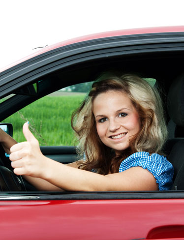 Women Driving Giving Thumbs Up