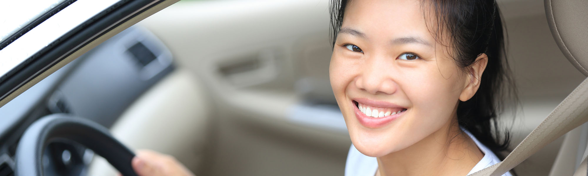 Happy Woman Smiling While Driving